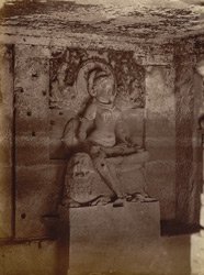 Amba in a small chapel in court of Indra Sabha [Sculptured figure of Indrani or Amba seated on a lion in a small cave in the courtyard of Jain Cave XXXII (Indra Sabha), Ellora.]